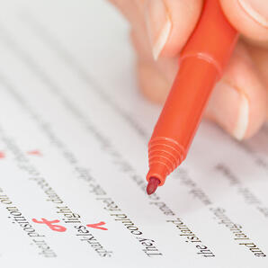 Editing document with red pen